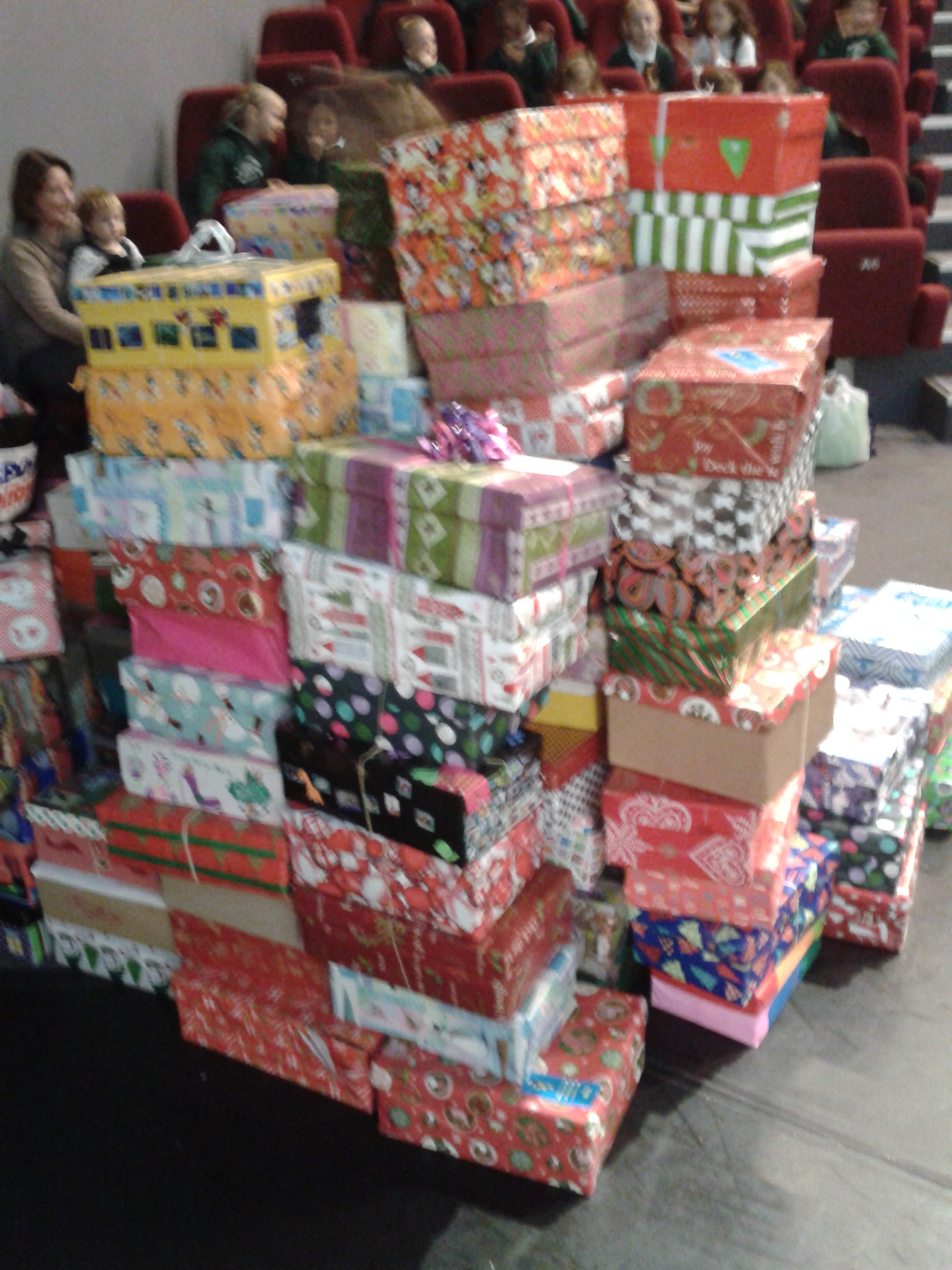 Elementary Students Fill Shoeboxes With Gifts For Children In Need